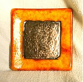 svietnik oranžový