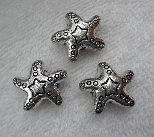 Plast hviezda 22x11mm-st.str-1ks