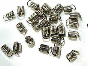 Komponenty - Konc.pružinka 9x6mm-1ks - 1021758